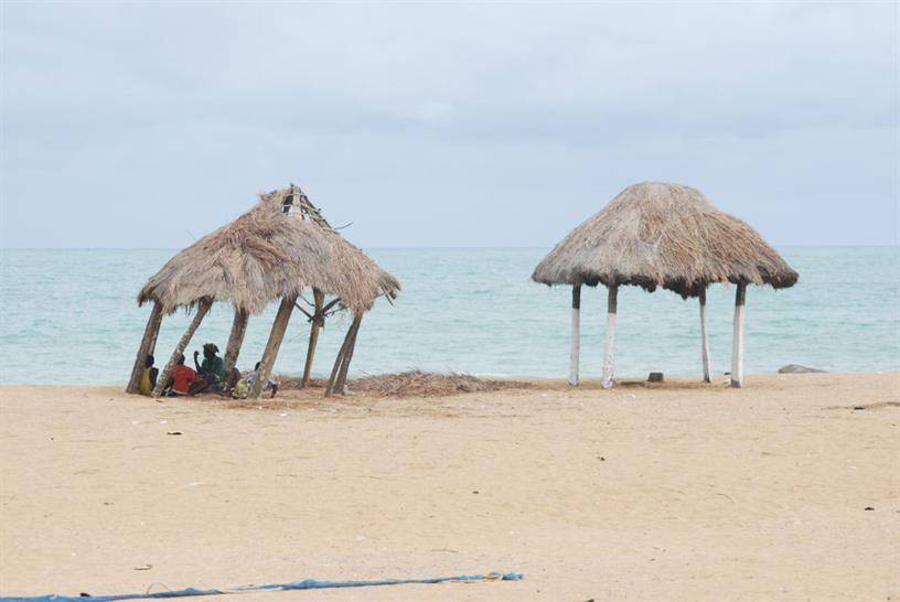 Shade from the sun on the beach in Benin