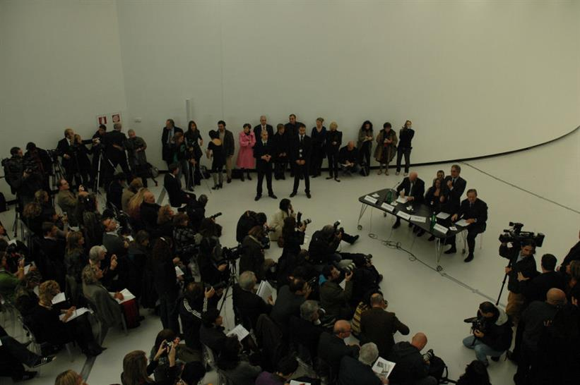 A packed audience of journalists capture Zaha