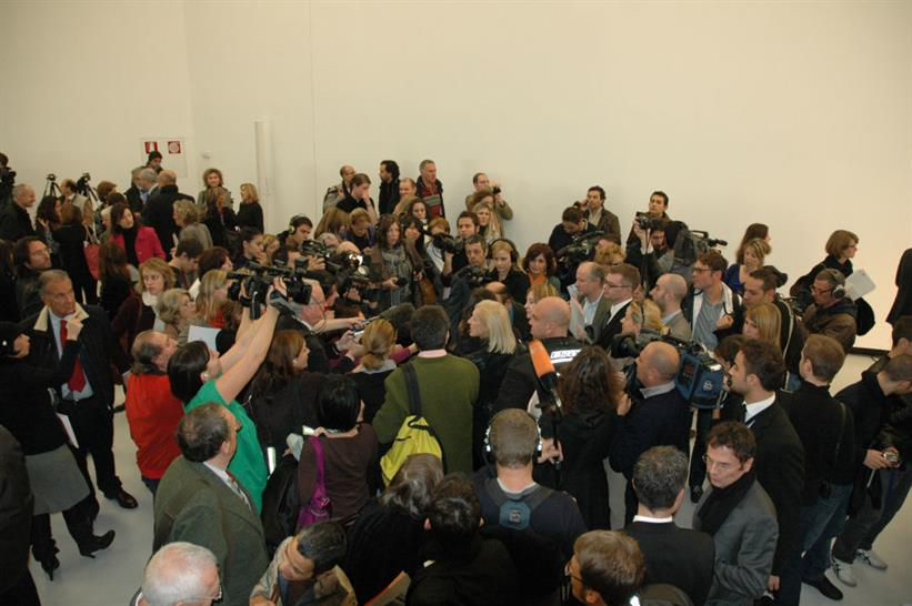 Zaha is swamped by a swarm of journalists
