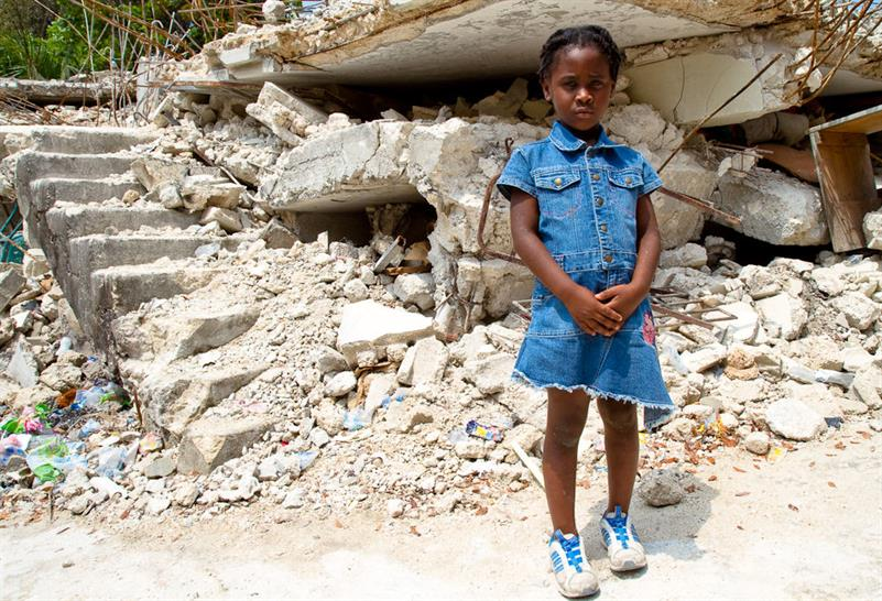 Girl outside destroyed school in Petitionville, Haiti, where Article 25 is delivering a 27-school reconstruction programme. (© Wayne Rowe photography)