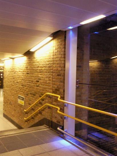 Internal stairwell navigates through existing Victorian buttress