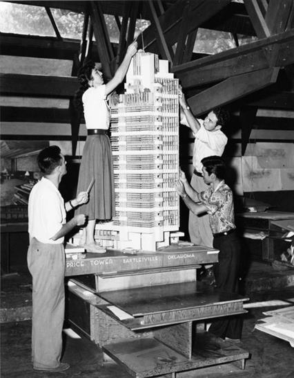 . C. Price Company Tower, Bartlesville, Oklahoma, 1952–56. Apprentices working on the model in the Taliesin drafting room. Spring Green, Wisconsin, c. 1952. Gelatin silver print on paper, 7 3/4 x 9 1/2in. The Frank Lloyd Wright Foundation Archives