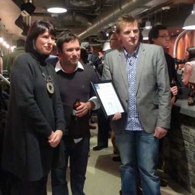 Paul Nicholson (right) accepting his certificate upon being shortlisted for the 2011 Retail Interiors Awards