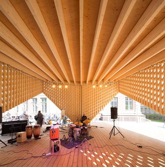 """<a href=""""https://backstage.worldarchitecturenews.com/wanawards/project/a-lava-summer-stage/"""" target=""""_blank"""">A-lava Summer Stage</a> by Aalto University Wood Program © Marc Goodwin"""