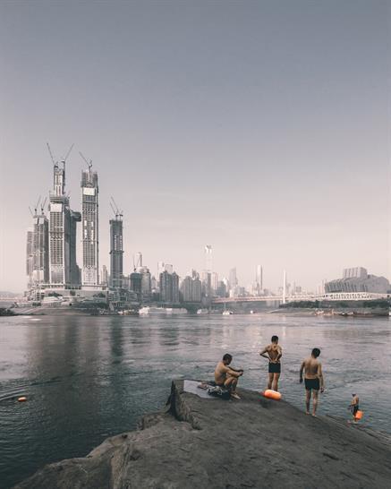 Swimmers opposite Raffles City Chongqing, China, by Zhu Wenqiao