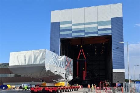 The massive nacelle arrives at the facility