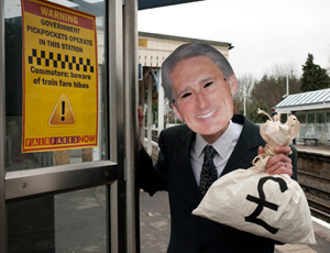Fair Fares Now campaigner wearing a Philip Hammond mask