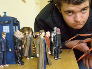 Young person with his Doctor Who toys (credit: Sam Dawes/KIDS/PhotoVoice)